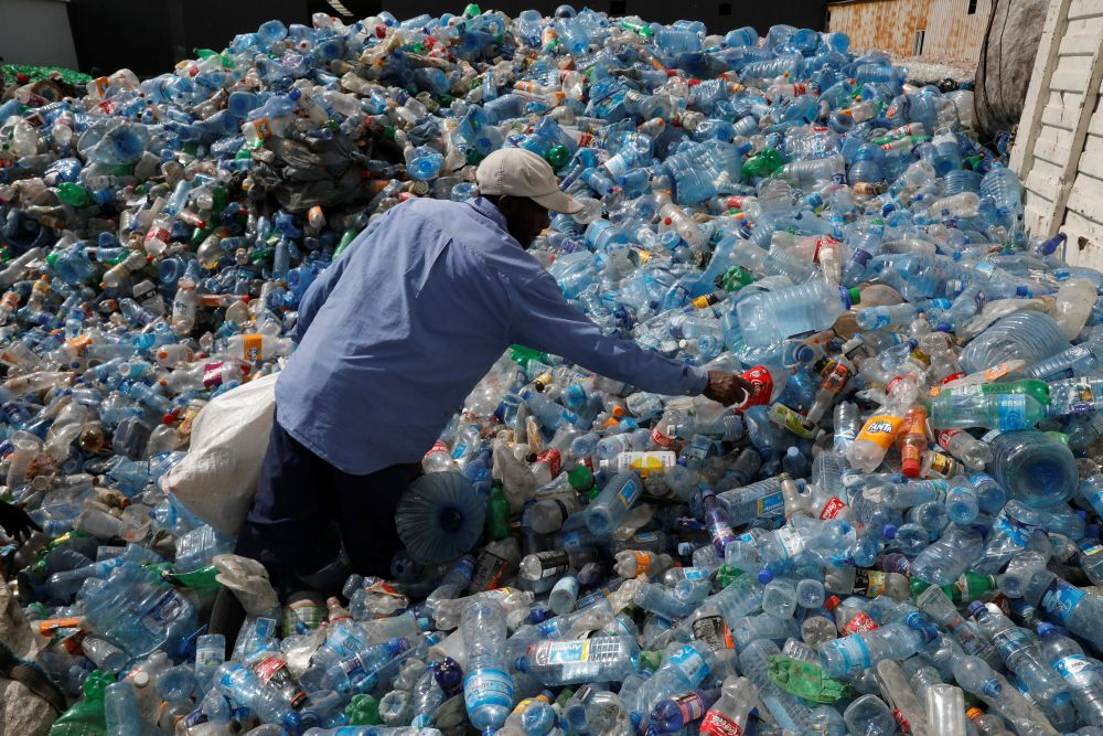 An employee sorts plastic bottles at the Weeco plastic recycling factory at the Athi River industrial zone near Nairobi, Kenya, May 15, 2019. Picture taken May 15, 2019. REUTERS/Baz Ratner