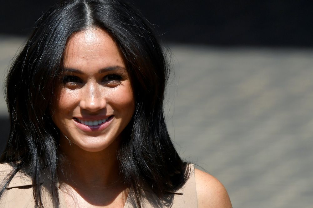 Britain's Meghan Markle, Duchess of Sussex, leaves after meeting academics and students for a roundtable discussion on female access to higher education with the Association of Commonwealth Universities, at the University of Johannesburg, Johannesburg, So