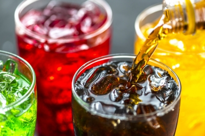 Drinking soft drinks linked to obesity, tooth wear