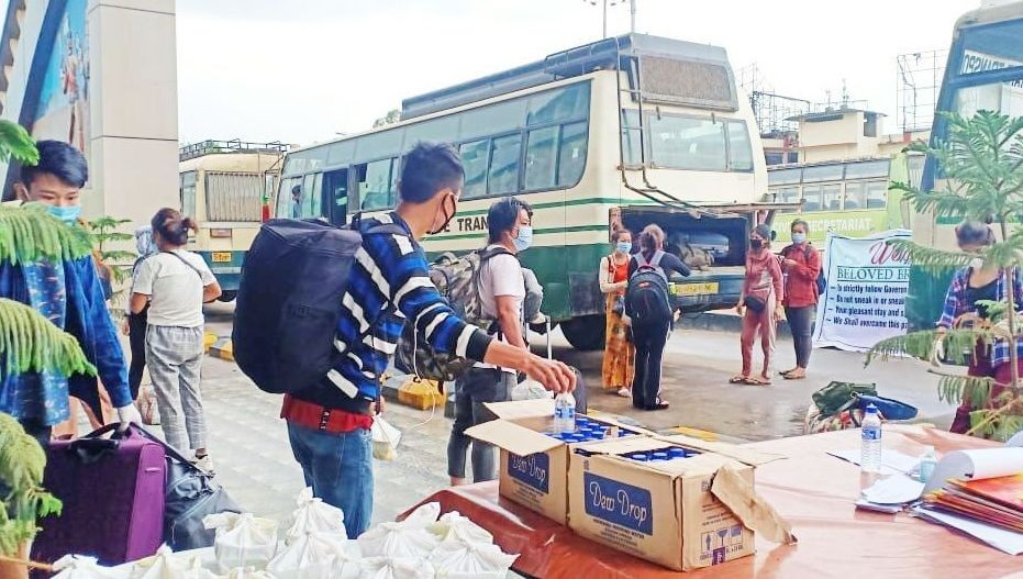 The returnees were transported to Agri Expo, 4th Mile, from Dimapur Railway Station in a fleet of buses arranged by the state government. (Morung Photo)
