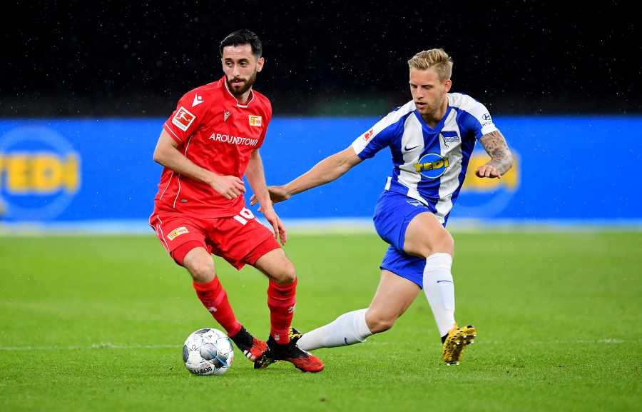 FC Union Berlin's Yunus Malli in action with Hertha BSC's Arne Maier, as play resumes behind closed doors following the outbreak of COVID-19. REUTERS