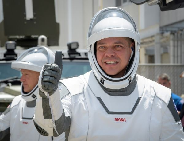 NASA astronauts Robert Behnken, foreground, and Douglas Hurley, wearing SpaceX spacesuits, are seen as they depart the Neil A. Armstrong Operations and Checkout Building for Launch Complex 39A to board the SpaceX Crew Dragon spacecraft for the Demo-2 mission launch, May 30, 2020, at NASA's Kennedy Space Center in Florida. (REUTERS Photo)