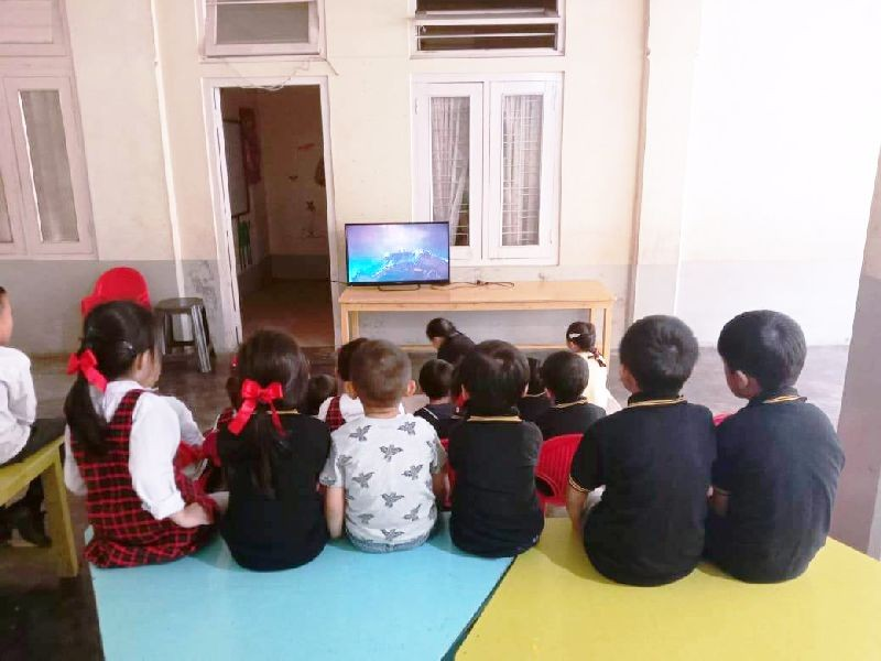 Children of Bumblebee Inclusive School, Kohima watching a movie. (Morung Photo)