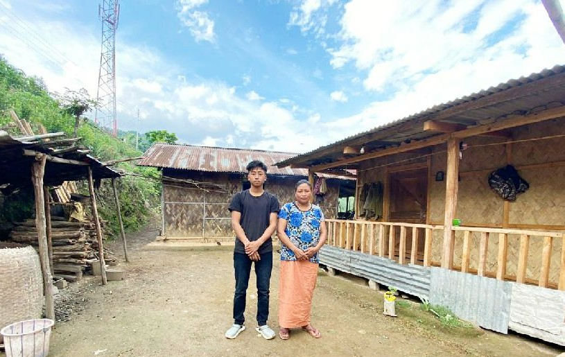 Chumliba R from LHSSK who secured Top-1 Position in HSSLC exam with his mother at Lihtsaoung Village, Kiphire town. (Morung Photo)