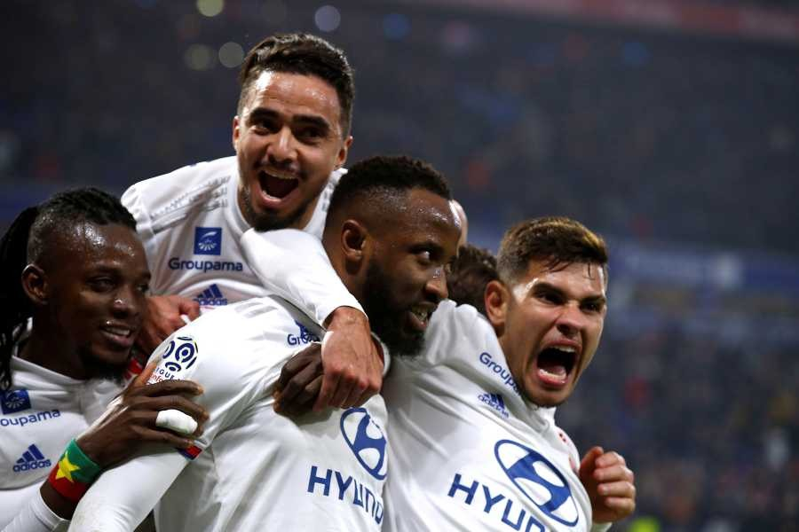 Olympique Lyonnais' Moussa Dembele celebrates scoring their second goal with teammates REUTERS/File Photo
