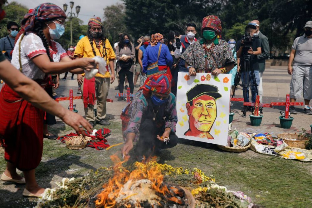 Mayan indigenous people take part in a ceremony in memory of Domingo Choc, a 56-year-old practitioner of traditional Maya medicine who was set ablaze by a mob accusing him of witchcraft, at the Parque Central in Guatemala City, Guatemala June 10, 2020. REUTERS/Luis Echeverria