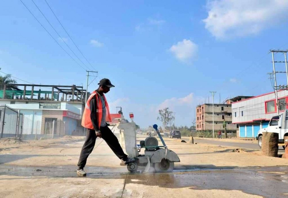 Representative Image: A worker uses a machine at the ongoing construction works along NH-29, Purana Bazar-Chümoukidima sector. The steady departure of migrant workers to their respective states has created a void in the construction sector in Nagaland.  (Morung File Photo)