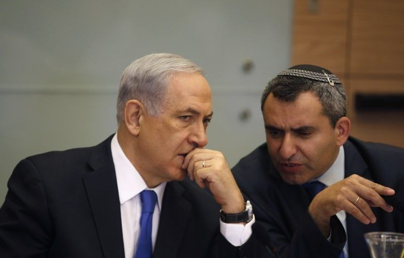 Israel's Prime Minister Benjamin Netanyahu (L) listens to Foreign Affairs and Defence committee chair Zeev Elkin during a committee meeting at parliament in Jerusalem on June 2, 2014. (REUTERS File Photo)