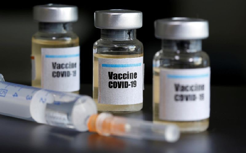 """Small bottles labeled with a """"Vaccine COVID-19"""" sticker and a medical syringe are seen in this illustration taken taken April 10, 2020. REUTERS/Dado Ruvic/Illustration/File Photo"""