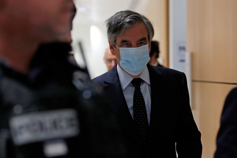 Former French prime minister Francois Fillon, wearing a protective face mask, arrives for the verdict in his trial over a fake jobs scandal at the courthouse in Paris, France on June 29. (REUTERS Photo)