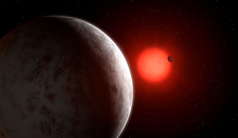 The multiplanetary system of newly discovered super-Earths orbiting nearby red dwarf star Gliese 887 is seen in this artist's impression. (REUTERS Photo)