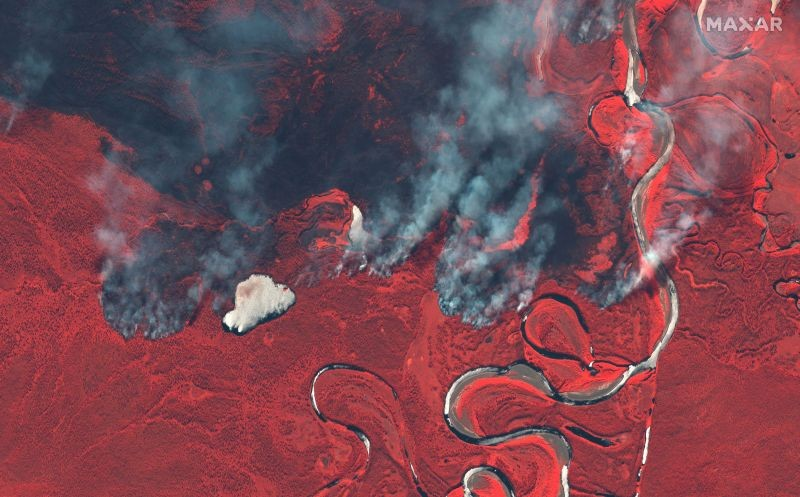 Smoke rises from wildfires near Berezovka River in Russia in this June 23, 2020 color infrared image supplied by Maxar Technologies. (REUTERS Photo)