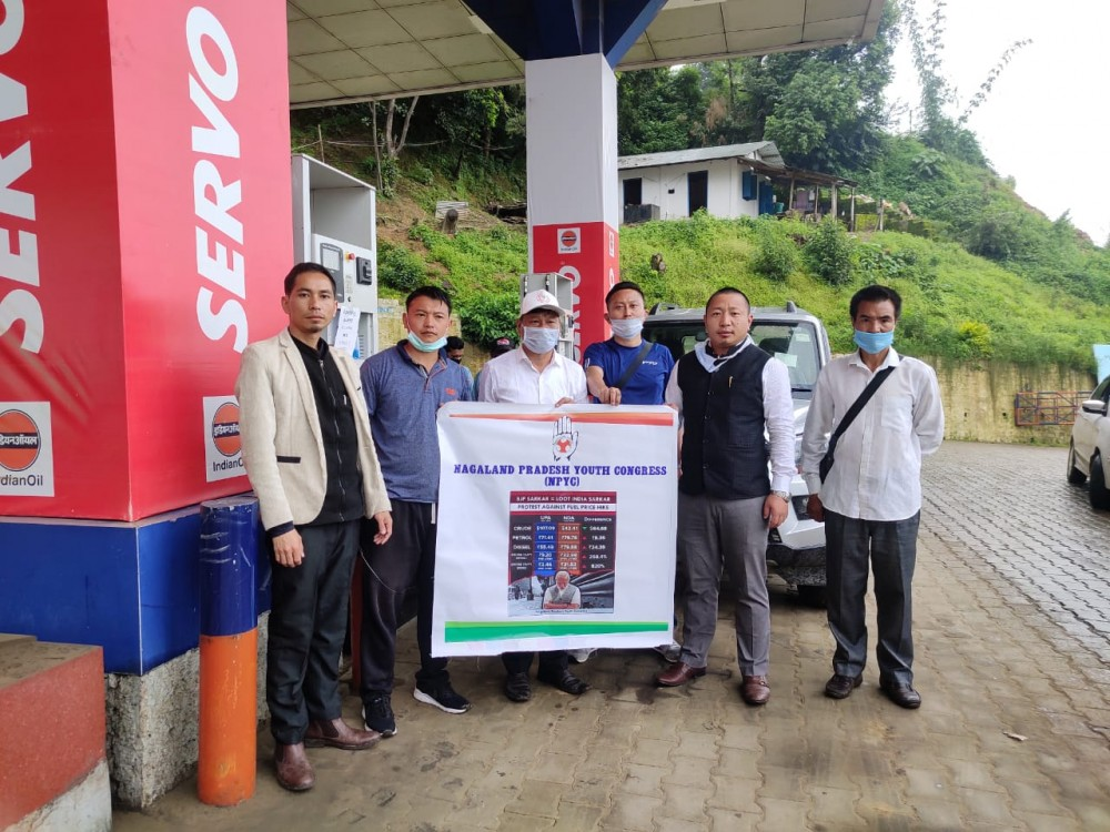 NPYC president Vilhousilie Kenguruse and others during poster campaign against fuel price hike in Kohima on June 29. (Morung Photo)