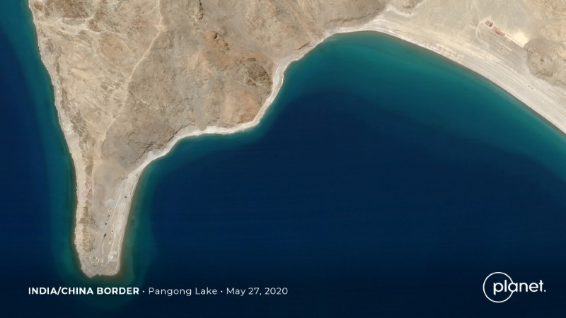 Build up at the Line of Actual Control on the disputed border between China and India is seen in this handout satellite image of Pangong Lake courtesy of Planet Labs taken May 27, 2020. Planet Labs/Handout via REUTERS/Files