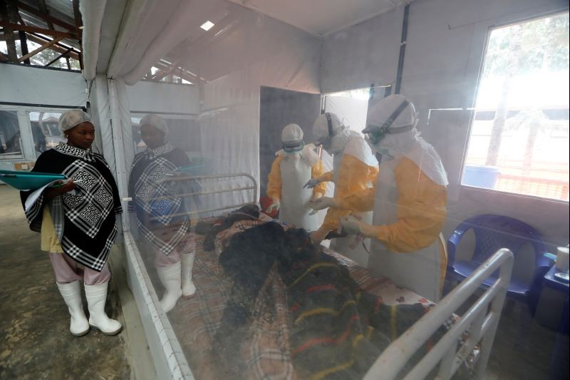 Moise Vaghemi, 33, (C) an Ebola survivor who works as a nurse, cares for a patient who is suspected to be suffering from Ebola, inside the Biosecure Emergency Care Unit (CUBE) at the Ebola treatment centre in Katwa, near Butembo, in the Democratic Republic of Congo on October 3, 2019. (REUTERS File Photo)