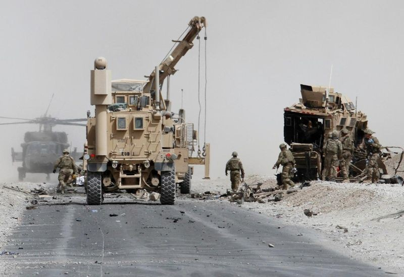 U.S. troops assess the damage to an armored vehicle of NATO-led military coalition after a suicide attack in Kandahar province, Afghanistan August 2, 2017. (REUTERS File Photo)