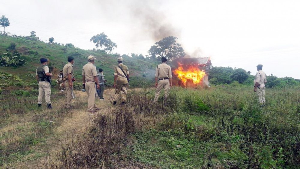 Anti-encroachment team burning down huts illegally constructed on Government-purchased land in Wokha district on July 10. (DIPR Photo)
