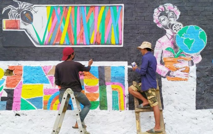 Three artists from Chizami painted mural arts at the Chizami welcome gate, local ground, and the administrative office. (Photo Courtesy: Chizami Students' Union)