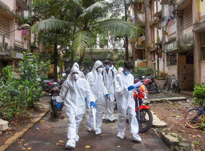 Health workers arrive to conduct door-to-door screening of residents of Dindoshi at Goregaon East in Mumbai. Photograph: PTI Photo
