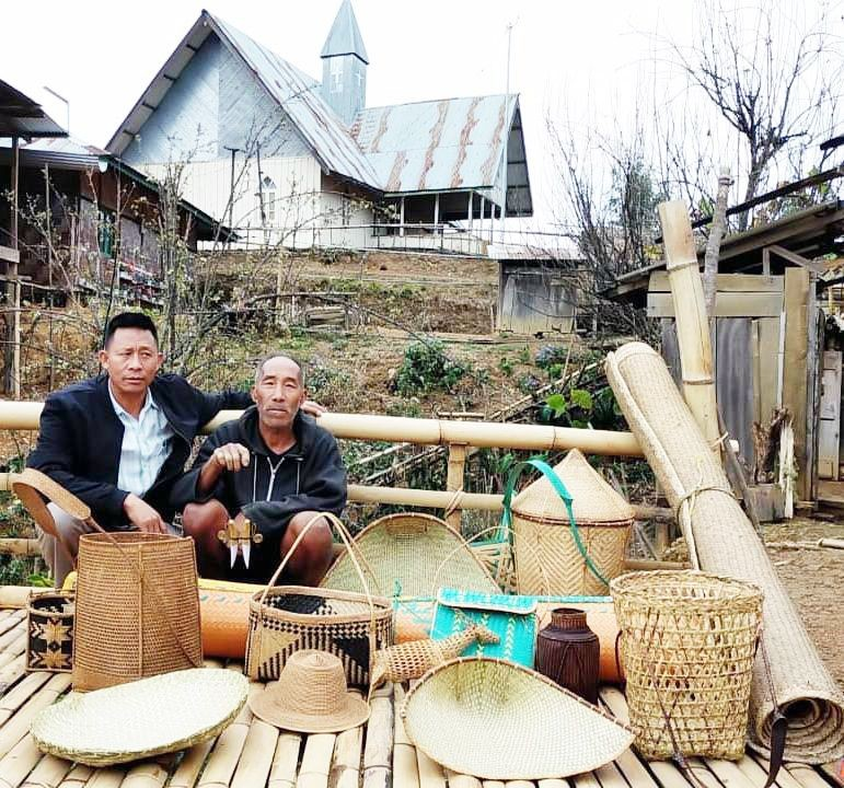 Sekiam (Right) with some his hand crafted products. (Morung Photo)