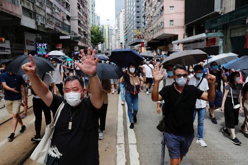 Anti-national security law protesters march at the anniversary of Hong Kong's handover to China from Britain in Hong Kong, China July 1, 2020. (REUTERS  Photo)