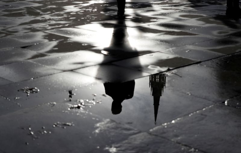 The Palace of Westminster and a man walking are reflected in a puddle in London, Britain on November 4, 2019. (REUTERS File Photo)