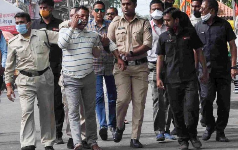 Gangster Vikas Dubey, the main accused in killing of eight policemen in the Kanpur encounter, being apprehended by police personnel after a nearly week-long manhunt, in Ujjain, Thursday. Photograph: PTI Photo