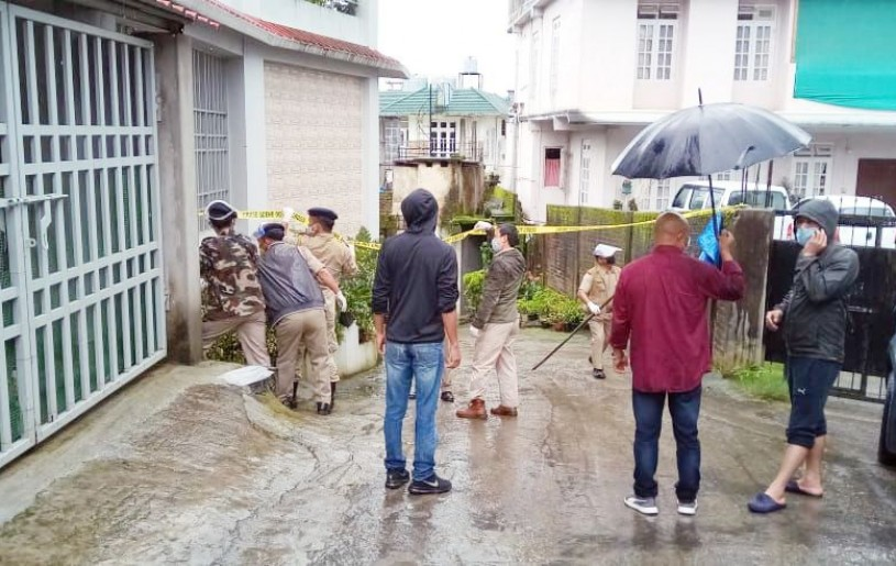 Police personnel marking off 'sealed areas' at Upper AG Colony in Kohima on July 12.