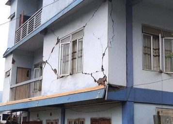 A house partially damaged by earthquake is seen in this picture shared on Twitter by the Mizoram Chief Minister   Zoramthanga on June 22.  (Photo: @ZoramthangaCM / Twitter)