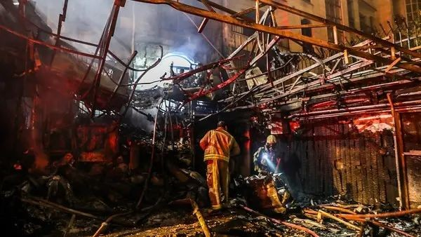 First responders search for survivors at the scene of an explosion at the Sina At'har health centre in the north of Iran's capital Tehran northern Tehran on June 30, 2020. (AFP)