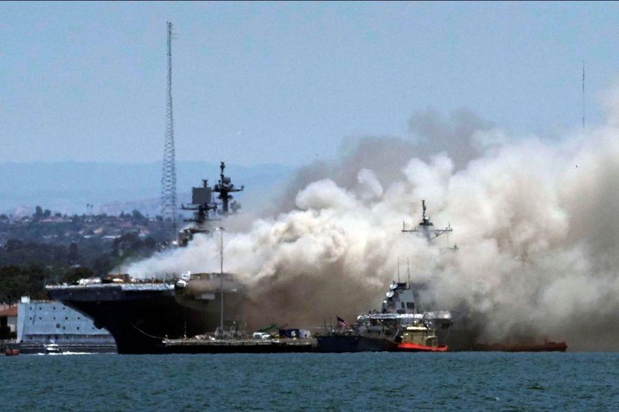 Smoke rises from a fire on board the U.S. Navy amphibious assault ship USS Bonhomme Richard at Naval Base San Diego, as seen from Coronado, California, U.S. July 12, 2020. REUTERS/Bing Guan
