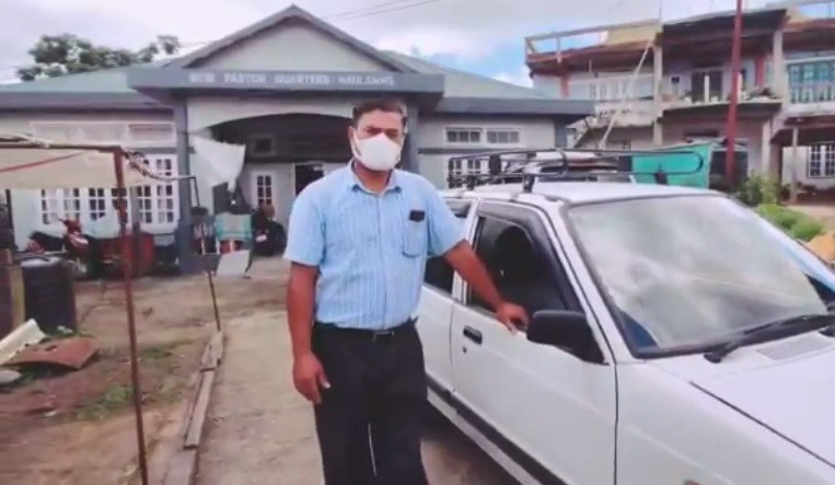 Israel Lalremtluanga, a pastor of Baptist church in southern Mizoram's Lunglei district, drives people to their villages and homes in his own car.