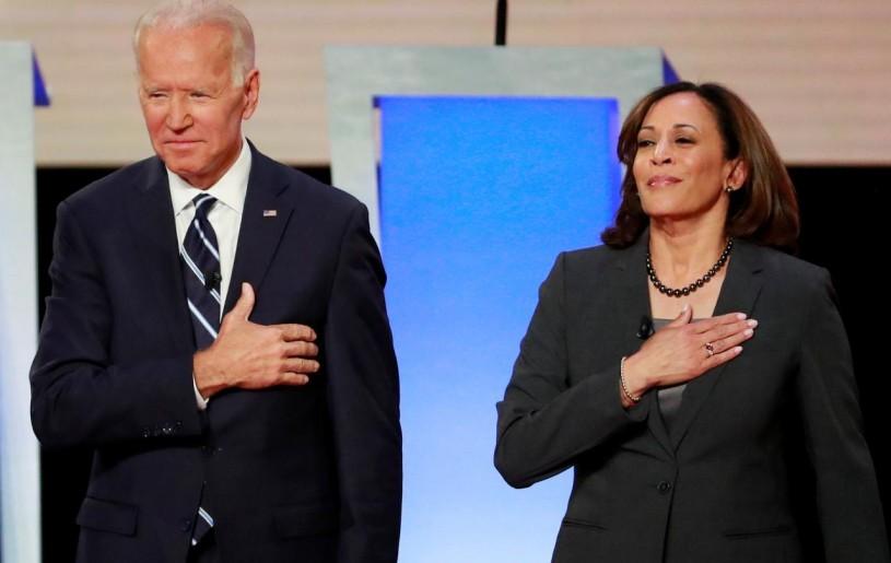 FILE PHOTO: Former Vice President Joe Biden and U.S. Senator Kamala Harris take the stage before the start of the second night of the second U.S. 2020 presidential Democratic candidates debate in Detroit, Michigan, U.S., July 31, 2019. REUTERS/Lucas Jackson/File Photo