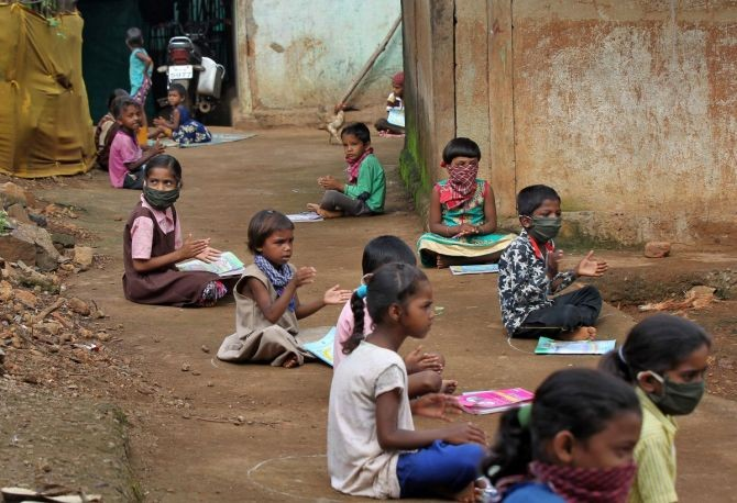 Children at a village in Maharashtra listen to pre-recorded lessons over loudspeakers. Image taken only for representational purposes. Photograph: Prashant Waydande/Reuters