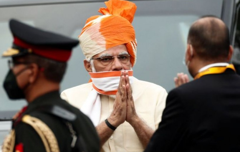 Prime Minister Narendra Modi greets officers as he arrives to attend Independence Day celebrations at the historic Red Fort in Delhi. Photograph: Adnan Abidi/Reuters