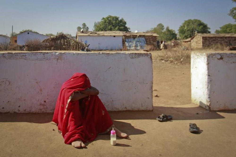 A 14-year-old girl cries in a village near Baran, in the northwestern state of Rajasthan, India, after her husband comes home drunk. Krishna married her husband when she was 11. Picture taken January 21, 2013. REUTERS/Danish Siddiqui