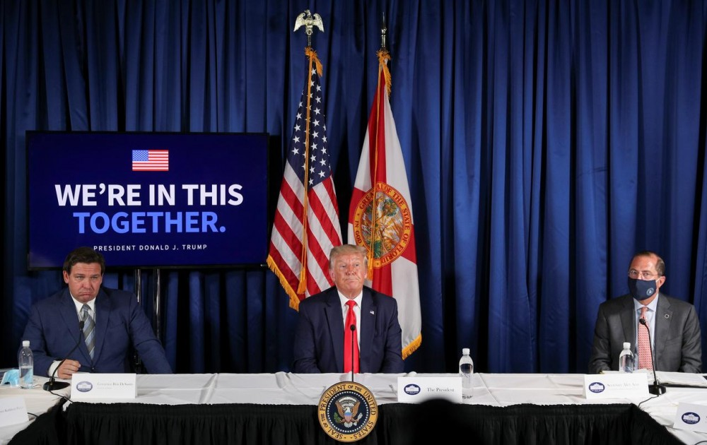 "U.S. President Donald Trump participates in a ""COVID-19 Response and Storm Preparedness"" event with Florida Governor Ron DeSantis and U.S. Health and Human Services (HHS) Secretary Alex Azar at the Pelican Golf Club in Belleair, Florida, U.S., July 31, 2020. REUTERS/Tom Brenner"