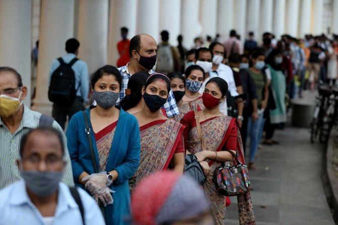People queue to enter a metro station in New Delhi, September 14, 2020. Photograph: Anushree Fadnavis/Reuters