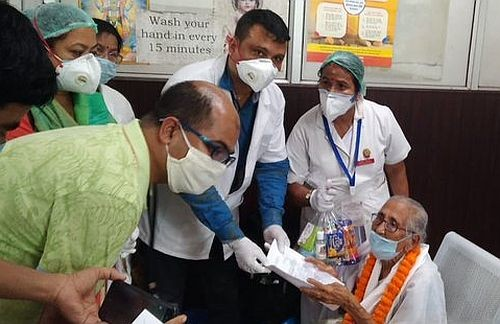 Mai Handique being felicitated by doctors after her recovery