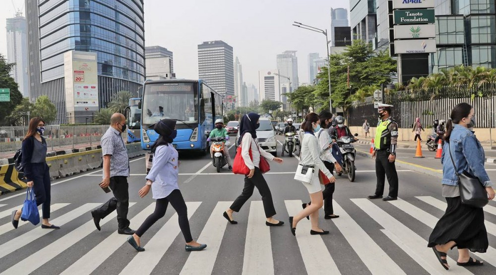 Global Coronavirus Updates, Sept 14: WHO records single-day rise in worldwide casesPeople wearing a face mask as a precaution against the new coronavirus outbreak, walk on a pedestrian crossing at the main business district in Jakarta, Indonesia, Monday, Sept. 14, 2020. (AP Photo)
