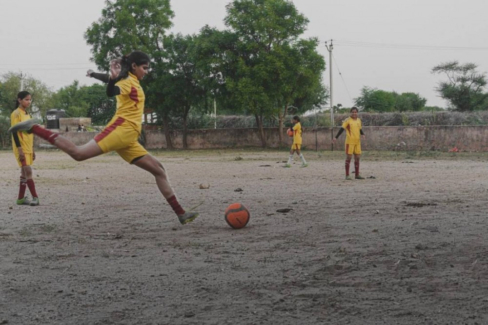 A football player practices in a village in Ajmer district, India. Picture credit: Mahila Jan Adhikar Samiti