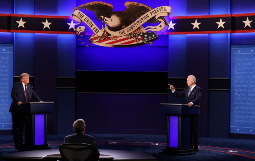 U.S. President Donald Trump and Democratic presidential nominee Joe Biden participate in their first 2020 presidential campaign debate held on the campus of the Cleveland Clinic at Case Western Reserve University in Cleveland, Ohio, U.S., September 29, 2020. REUTERS/Jonathan Ernst