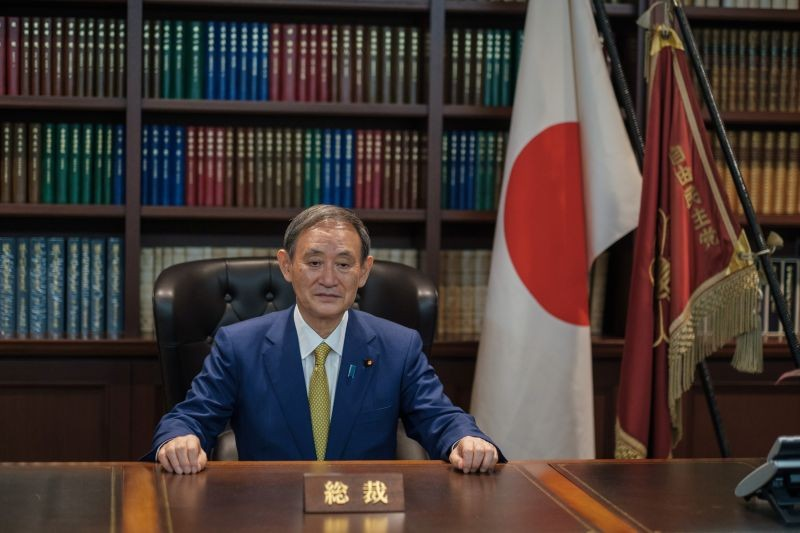 Japanese Chief Cabinet Secretary Yoshihide Suga poses for a picture following his press conference at LDP (Liberal Democratic Party) headquarters, in Tokyo, Japan September 14, 2020. Nicolas Datiche/Pool via REUTERS