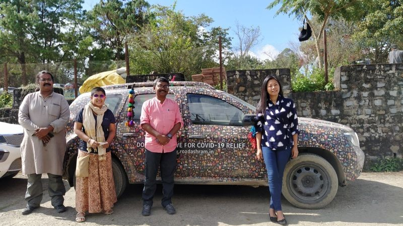 Members of 'Road Ashram' with founder of YouthNet, Hekani Jakhalu Kense posing in front of their custom crafted car in Kohima. (Morung Photo)
