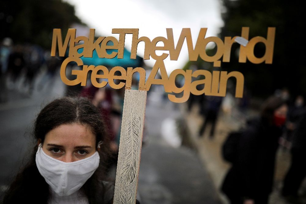 "A demonstrator holds a sign as Fridays for Future activists protest calling for a ""Global Day of Climate Action"" in Berlin, Germany, September 25, 2020. REUTERS/Hannibal Hanschke/File Photo"
