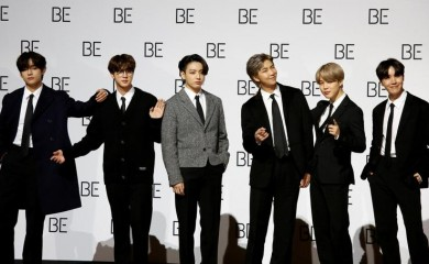 "Members of K-pop boy band BTS pose for photographs during a news conference promoting their new album ""BE(Deluxe Edition)"" in Seoul, South Korea, November 20, 2020. REUTERS/Heo Ran/File Photo"
