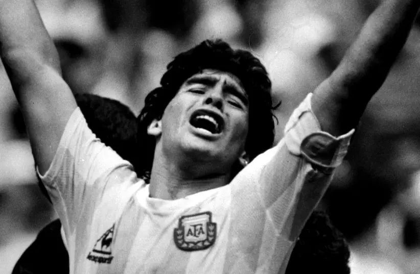 Argentine star Diego Maradona raises his arms in the air (photo credit: REUTERS)