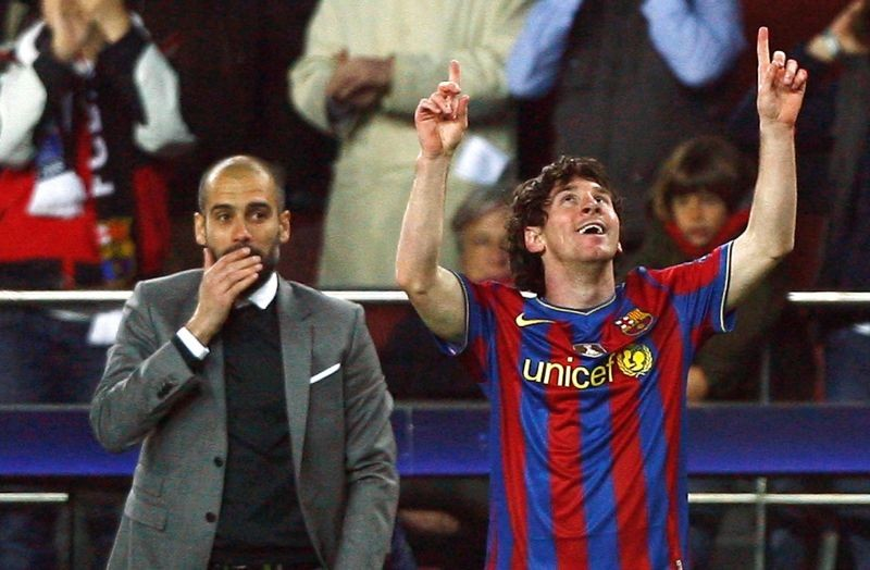 Barcelona's Lionel Messi (R) celebrates in front of Pep Guardiola after scoring a goal against VfB Stuttgart during their Champions League last 16, second leg soccer match at the Nou Camp stadium in Barcelona March 17, 2010. Picture taken March 17, 2010. REUTERS/Albert Gea/File Photo