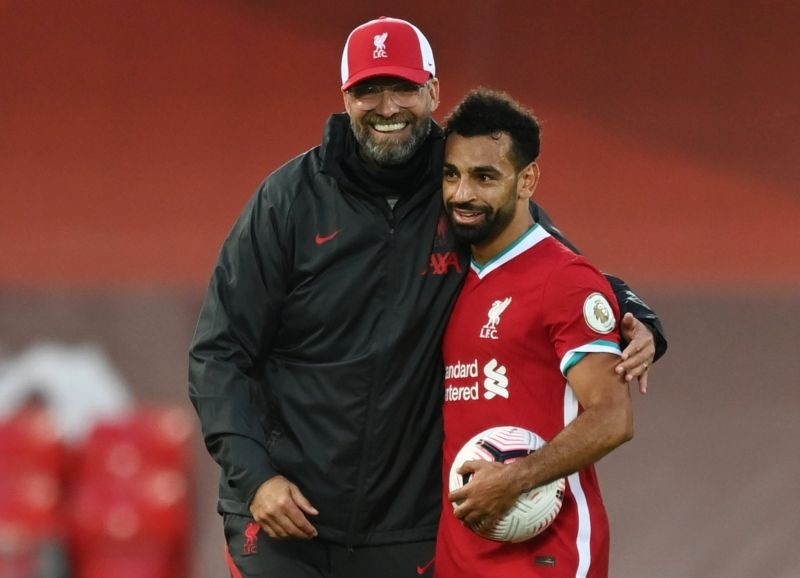 Liverpool's Mohamed Salah celebrates scoring a hat-trick with the match ball and Liverpool manager Juergen Klopp after the match Pool via REUTERS/Shaun Botterill/Files