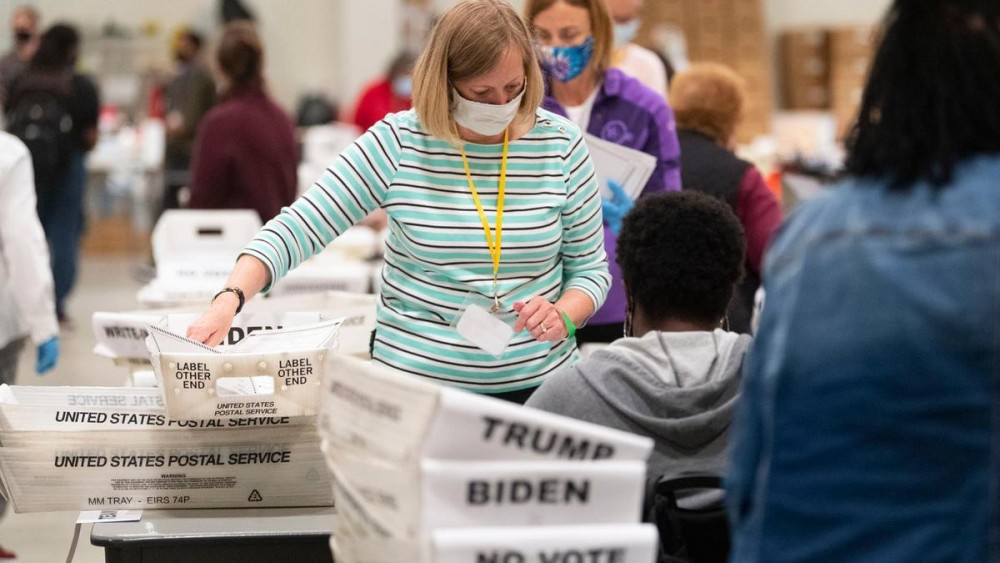 An election worker sorts through ballots during a Cobb County hand recount of Presidential votes. AP